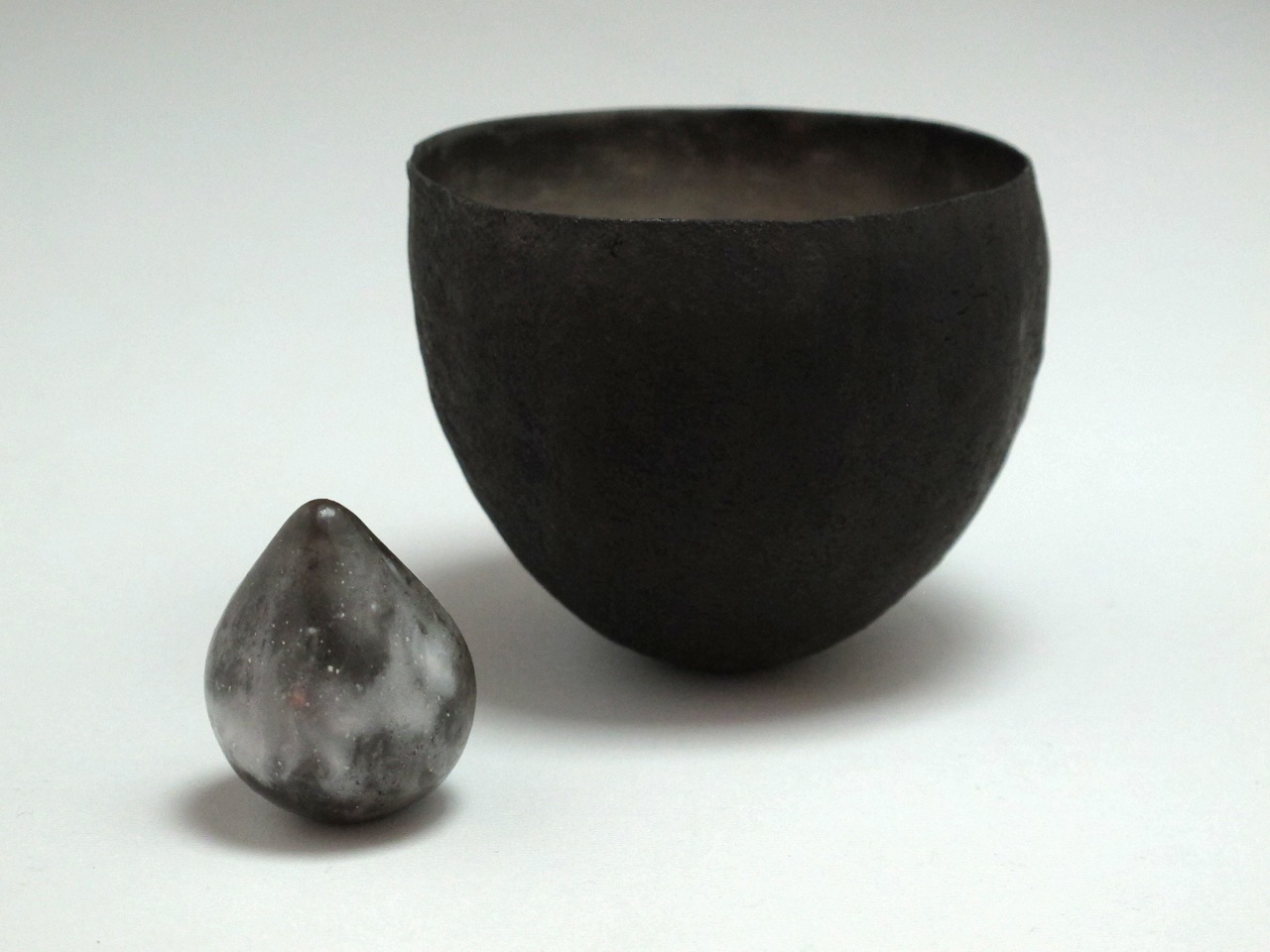 Black Speckled Vessel with Seed