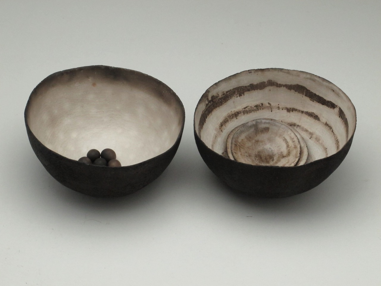 Set Piece; Two Large Vessels Two Small Ceramic Shells and Small Seeds