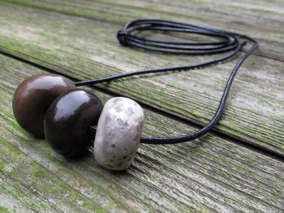 Twiddle Necklace, Ceramic Beads on Leather Cord by Karen Banks at the Saffron Walden Gallery